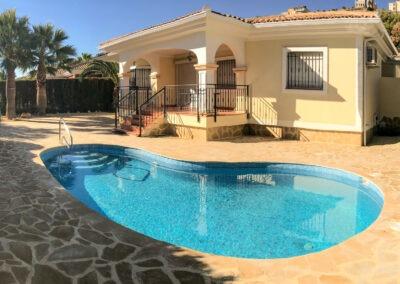 Kidney shape pool with Crazy Paving terraces in Bonalba